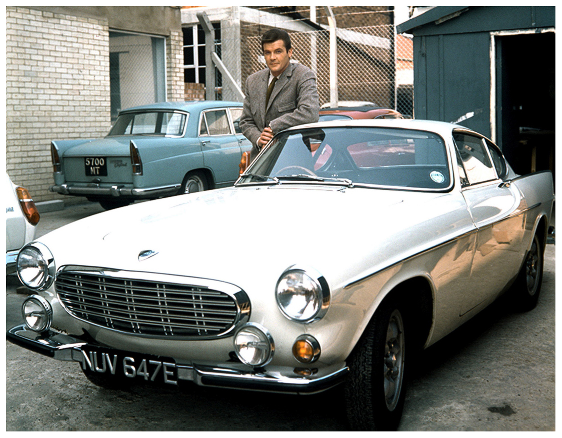 roger moore as the saint with his volvo p1800 pleasurephoto. Black Bedroom Furniture Sets. Home Design Ideas