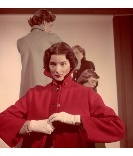 Featured model wearing brilliant red wool coat in college fashions article 1948