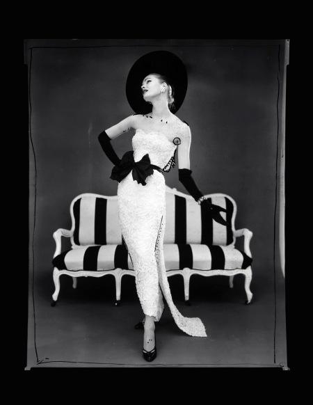 Model in evening dress designed by John Cavanagh, 1957