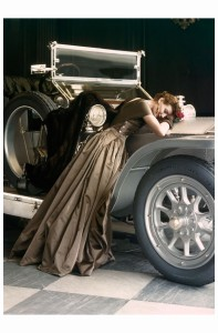 Wenda over the Rolls, Wenda Parkinson wearing a satin Molyneux evening gown, posing with a 1907 silver Ghost Rolls Royce, Vogue April - 1950