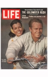 Cover of LIFE magazine dated 07-12-1963 w. logo & pic of actor Steve McQueen w. wife on motorcycle; photo by John Dominis