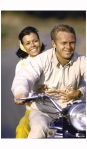Cover of LIFE magazine dated 07-12-1963 w. logo & pic of actor Steve McQueen w. wife on motorcycle; photo John Dominis