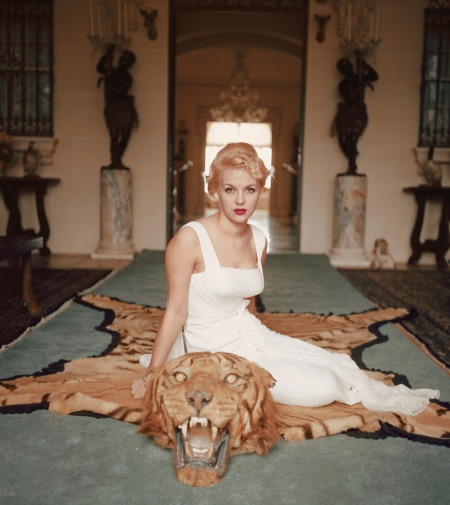 lady-daphne-cameron-sits-on-a-tiger-pelt-in-the-trophy-rooms-of-laddie-sanfords-palm-beach-house-1959