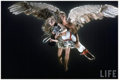 "Actress Jane Fonda being carried through the air by Guardian Angel, actor John Phillip Law, in a scene from Roger Vadim's film ""Barbarella."""