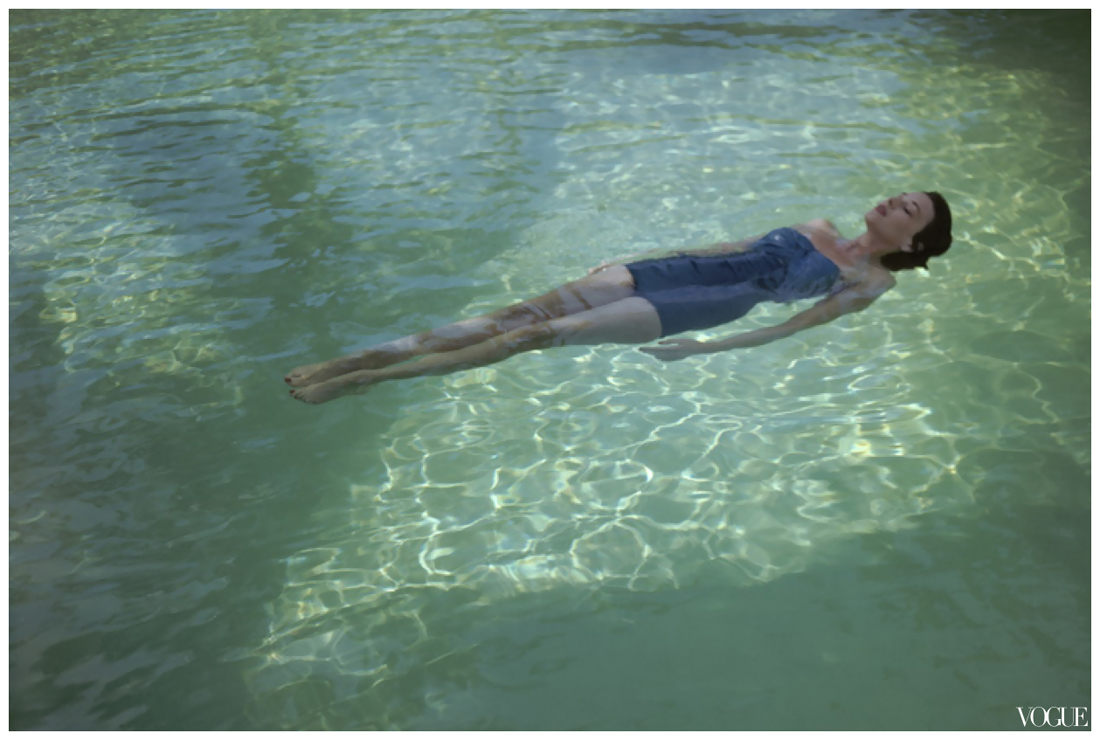 Original Caption Model In Blue Bathing Suit Floating On Her Back In A Swimming Pool Vogue