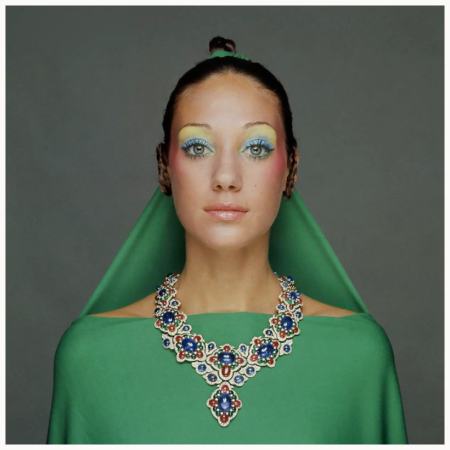 New York City, New York State, USA --- Marisa Berenson wearing a green drape and matching hair veil, tied to her topknot hairdo, with a necklace of gold, diamonds, rubies and emeralds by Bulgari; make-up including yellow eyeshadow at brow line, pale green on lid, pink lipstick and pink at cheekbones by Alexandre de Markoff. Circa September 1970 --- Image by © CondÈ Nast Archive/Corbis