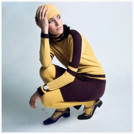 Photo David McCabe 1967 Model wearing a fitted yellow turtleneck with purple stripes and purple A-line skirt, both by Victoire for Korigan over yellow tights by Danskin Condè Nast
