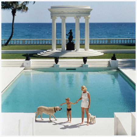 Mrs F C Winston Guest (aka Cee Zee Guest) and her son Alexander Michael Douglas Dudley Guest in front of their Grecian temple Villa Artemis, Palm Beach Photo Slim Arons 1955