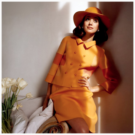 Photo Henry Clarke - Marisa Berenson in Orange - Model Marisa Berenson wearing an orange skirt suit with a double-breasted jacket featuring color-blocked sleeves, with matching wide-brim hat, all by the Italian designer Mila Schon. Circa March 1968