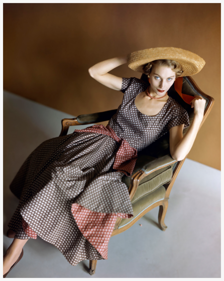 Photo Horst P. Horst - Vogue 1948 Model in Chair Wearing Straw Hat - Original caption - Woman seated in chair with multi-colored dress and wide brimmed straw hat.