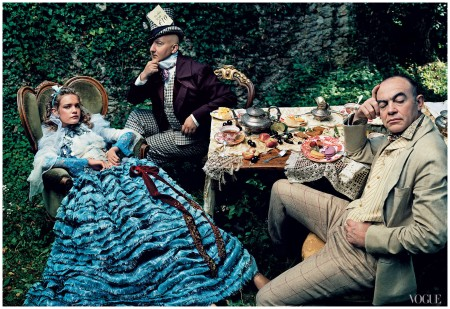 Photographed by Annie Leibovitz Natalia Vodianova as Alice, with milliner Stephen Jones as the Mad Hatter, and designer Christian Lacroix as the March Hare, 2003 Vogue, 2003