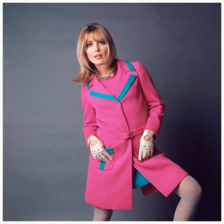 Sharon Tate in fuschia coat ca. 1967 Sharon Tate, wears a bright pink coat with turquoise trim, over a matching pink tank-top and gored turquoise hip skirt, by Luba for Elite; she accessorized with white racing gloves and textured white tights Condè Nast