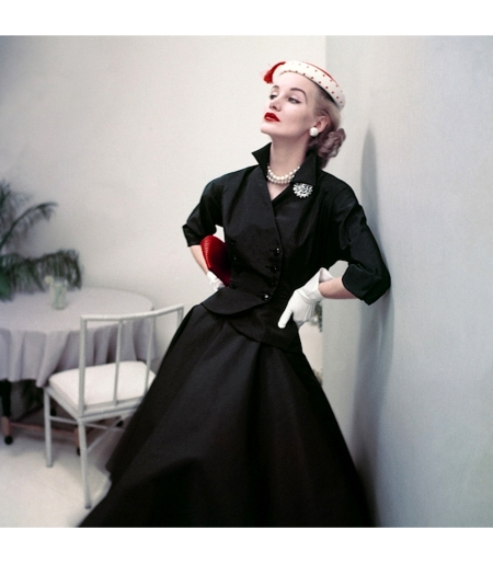 Sunny Harnett wearing suit with circle skirt, Glamour June 1952