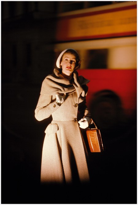 Wenda Parkinson wearing a Hardy Amies coat. A London bus can be seen in the background Vogue-June-1949 Photo Norman Parkinson Archive