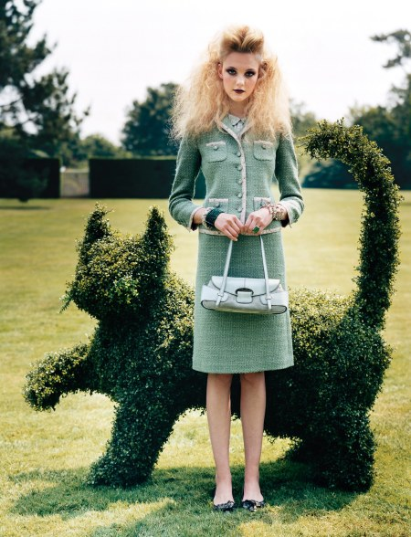 Caroline Trentini stands in front of a cat-shaped topiary Arthur Elgort, Vogue, September 2004