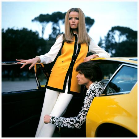 Model Veruschka standing in the doorway of a yellow Maserati Ghibli with Hiram Keller Franco Rubartelli 1969