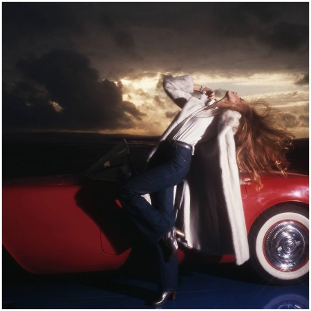 Jerry Hall on a Corvette, 1976