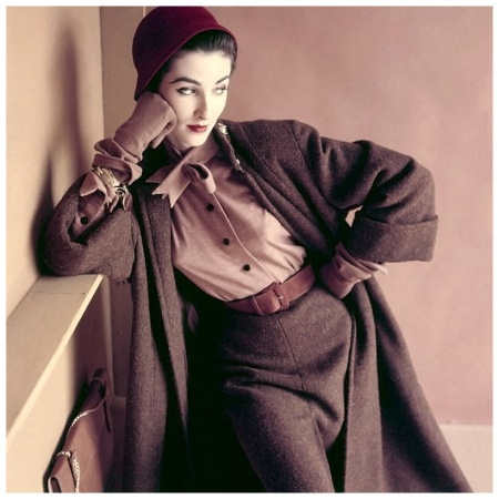 A tweed coat, matching slim skirt and wool jersey blouse with neckline tie, matching gloves and raspberry cloche hat, 1952 Photo by Richard Rutledge