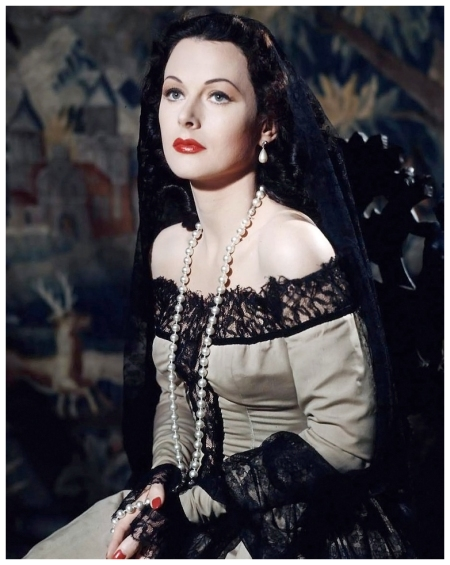 Hedy Lamarr is photographed by Eliot Elisofon in the style of a Renaissance portrait against the backdrop of an old tapestry, Los Angeles, 1946