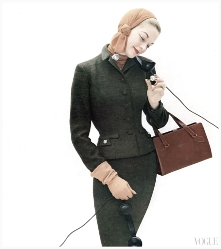 Jean Patchett in elegant suit by Handmacher as seen in Vogue US, August 1, 1953