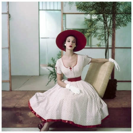 Jean Patchett in red and white polka dot summer dress with petticoat ruffle, hat and gloves Photo Frances Mclaughlin-Gill