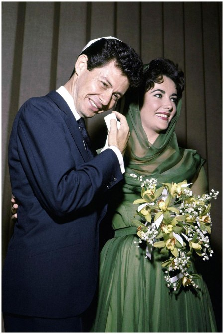 MAY 12 1959 – Liz married her fourth husband Eddie Fisher in Las Vegas. She wore a green dress and a chiffon headscarf