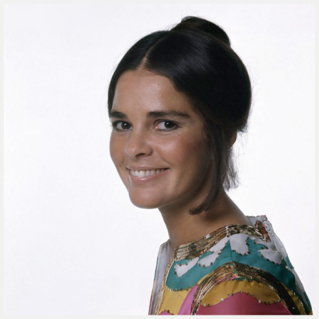 Photo Bert Stern Ali MacGraw in a bright printed silk dress with gold paillete trim by Oscar de La Renta 1970