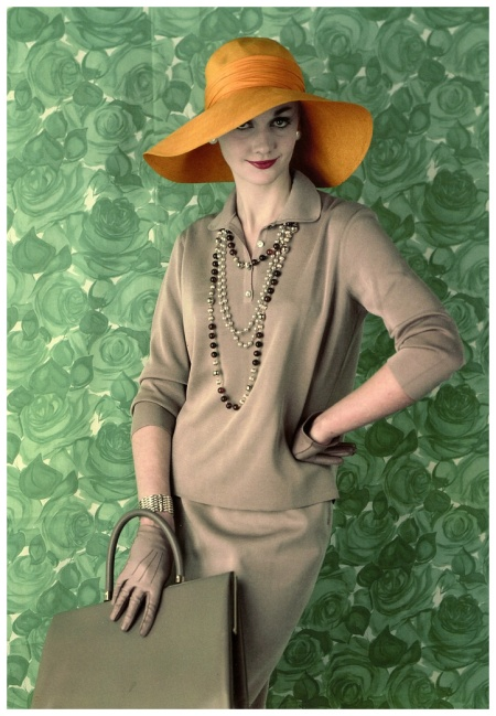 Ros Watkins in silk jersey by Matita Overseas, hat by Otto Lucas, mocha calf handbag by Jane Shilton, rope beads by Jewelcraft, photo by Vernier, Vogue, March 1959