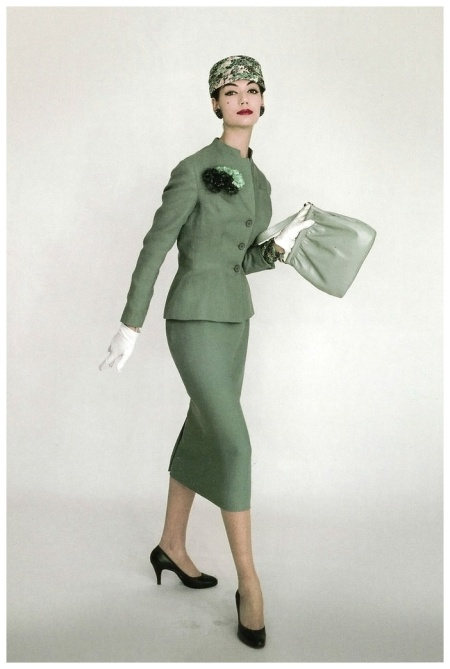 Simone d'Aillencourt in elegant linen suit and flower pot hat, photo by Vernier, Vogue UK, April 1956