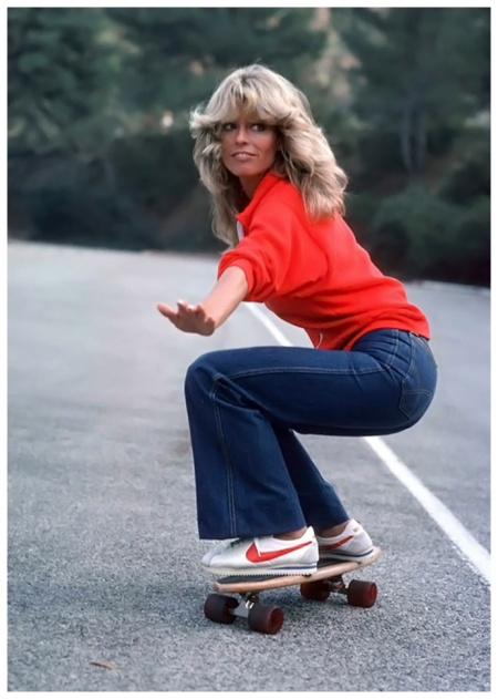 Actress Farrah Fawcett, wearing jeans, sweatshirt and Nike athletic shoes, practices skateboarding for an episode of Charlie's Angels 1977 Bettman