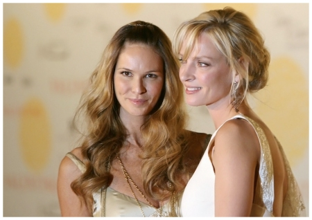 Australian model Elle McPherson (L) and