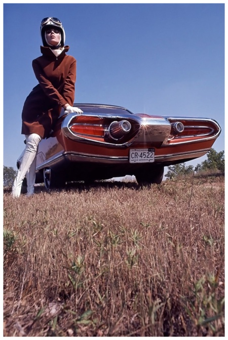 Leaning on a Chrysler Turbine, model wearing cinnamon corduroy shirt-coat-dress with white leather boots 1963 Photo Gene Laurents