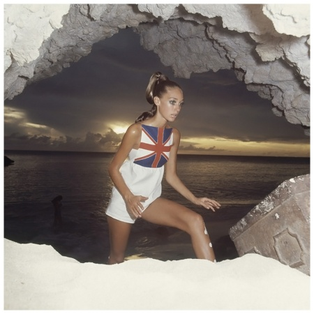 Model Marisa Berenson wearing a white cotton jumpsuit with Union Jack bodice, by Mr. Dino Photo Arnaud de Rosnay