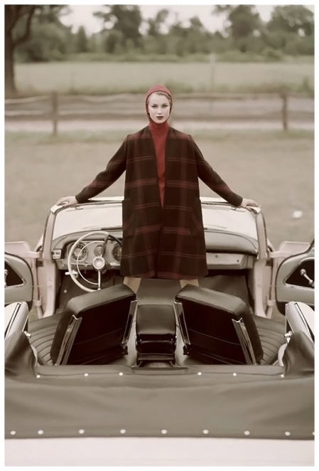 model-standing-1959-chrysler-new-yorker-convertible-wearing-navy-and-red-plaid-coat-over-red-sweater-with-hood-by-pendleton-1959-photo-john-rawlings