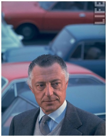 Pres. of Fiat Gianni Agnelli standing w. cars in bkgrd 1967 David Lees