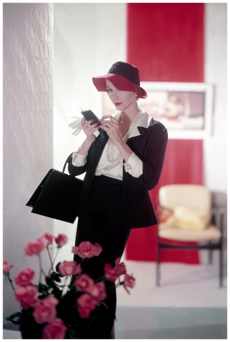 Model Evelyn Tripp in blue suit with matching bag and blue hat with red brim 1957 Horst P.Horst
