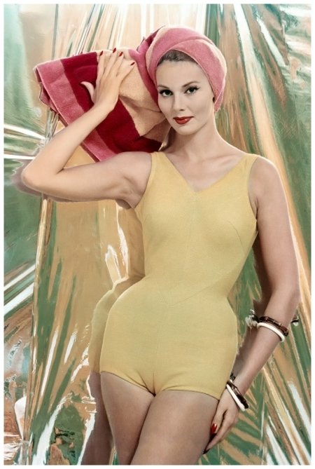 Model in yellow swimsuit of knitted cotton and Orlon, by Jantzen, photo by William Bell, 1959 Condé Nast Montrose Digital Archive