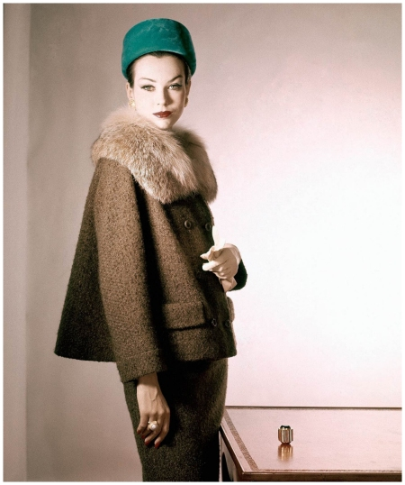 Model wearing suit of tobacco-brown wool tweed with a Canadian lynx collar. Accented with emerald green velvet hat 1959 Horst P. Horst