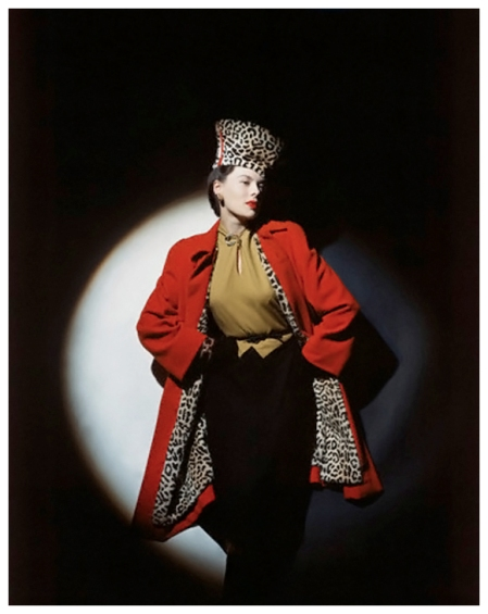 P Model wearing wool jersey dress, red wool overcoat with leopard-stencilled lapin lining, and chechia Photo John Rawlings 1942 Corbis