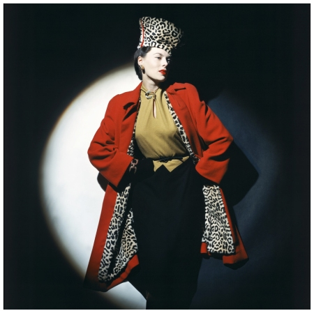 P Model wearing wool jersey dress, red wool overcoat with leopard-stencilled lapin lining, and chechia Photo John Rawlings 1942