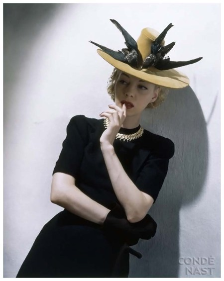 Photo Toni Frissell 1939 Model is wearing a snooded velvet buccaneer hat with life-size blackbirds