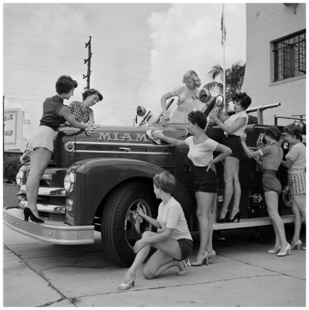 Bunny Yeager, models pose at a fire station in Miami Beach, Fla. Yeager was a model who become a pin-up photographer in the 50's and 60's. (AP Photo:Copyright Bunny Yeager)