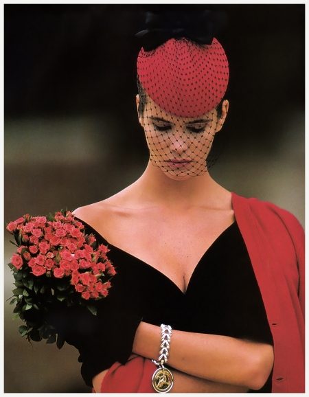 Elle Macpherson strikes an artful pose, cocktail hat, blusher and all, in the throwback fashion story, %22Flirting With the Fifties.%22 (November 1987)