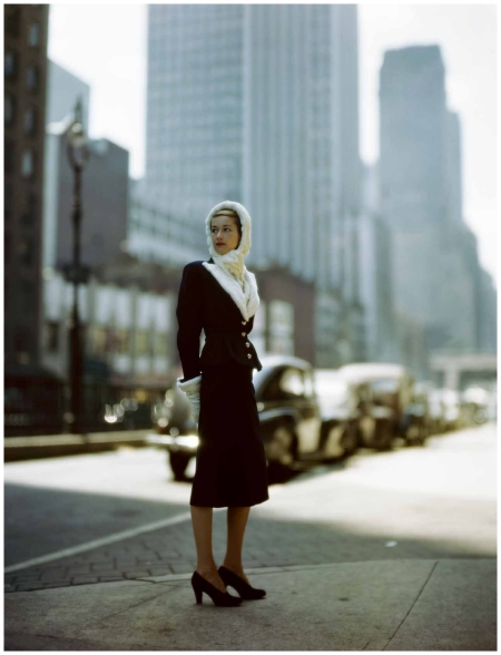 Model in cityscape wearing navy blue suit with Russian ermine trim from Kraus together with ermine hood by Sally Victor - Suit up with a dash of fur circa 1946 - Photo Constantin Joffe