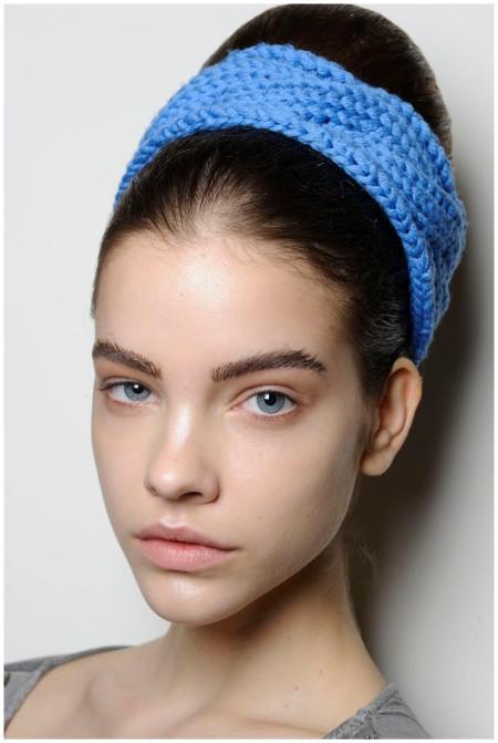 Barbara Palvin Prada Chunky, knitted headbands wrapped around neat buns at Prada Photo By Firstview