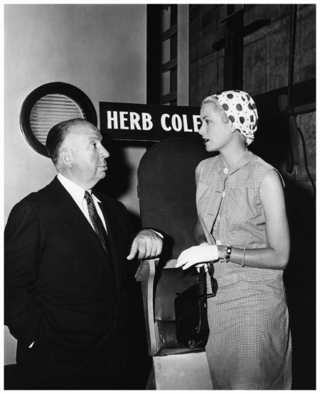 Grace Kelly with British director and producer Alfred Hitchcock on the set of his movie To Catch a Thief 1955