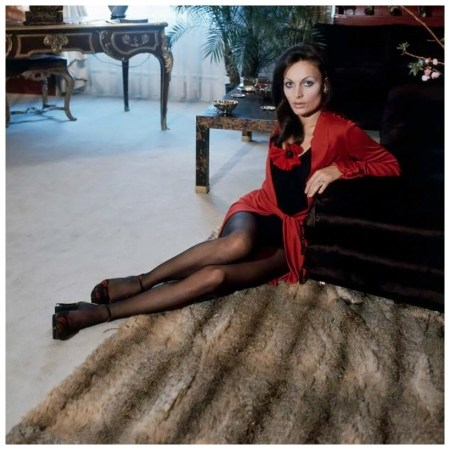Portrait of fashion designer Diane von Furstenberg sitting on the floor of her Manhattan apartment, wearing a black and red garment. Circa January 1972 Photo Horst P. Horst