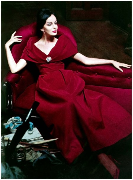 Red velvet drama circa winter 1960. Photographed by Helmut Newton