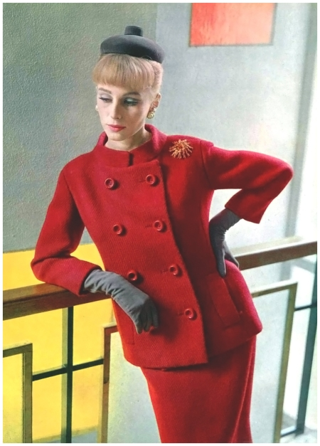 Model in elegant red wool suit featuring small mandarin collar by Pierre Cardin, photo by Pottier, 1963