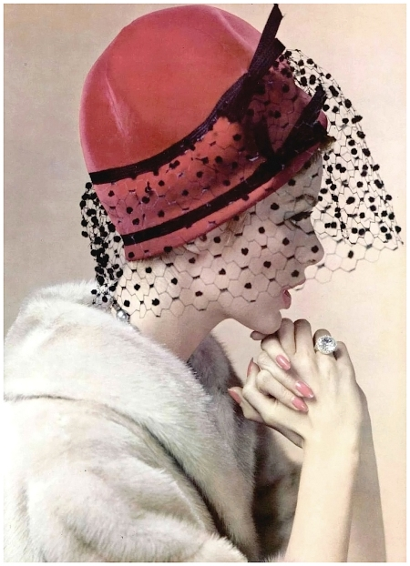 Model is wearing red velvet bonnet banded in satin piqué and voilette by Jean Barthet, fur by Marron, photo by Pottier, 1960